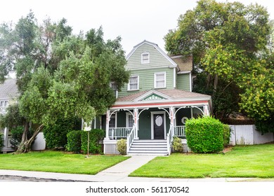 House decorated with trees and plants.