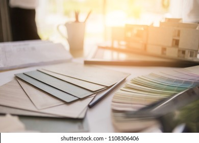 house design ideas concept with sample of material and color swatch on working desk