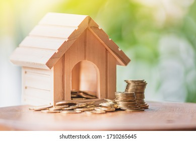 House designs on coins, heaps and natural backgrounds using them as assets, banks, finances and interest.