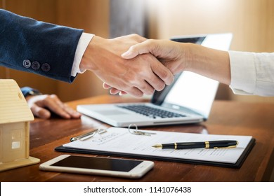 House developers agent or financial advisor and customers shaking hands after signing document making deal as successful agreement, contract with a firm