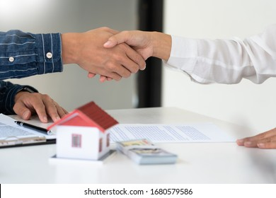 House developers and customer shaking hand after accept agreement finish buying or rental real estate for transfer right of property