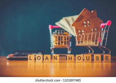 House dollar and Bitcoin on shopping cart the concept of investi