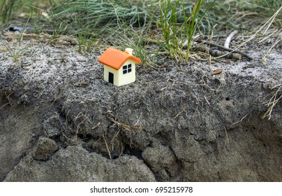House of dolls on the background of grass near the cliff
