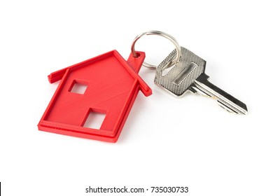 House door key with red house key chain pendant over white background