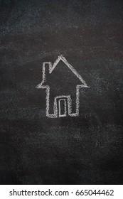 House drawn with white chalk on blackboard