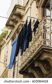 house with drying clothes in Syracuse, Sicily