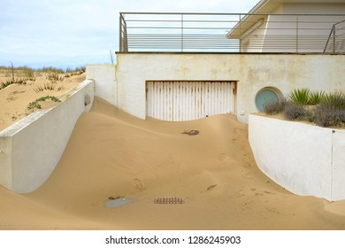 House entrance blocked by beach sand
