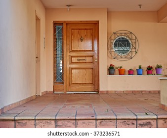 house entrance with colorful flowerpots, Athens Greece