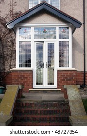 House entrance enlosed with a uPVC porch