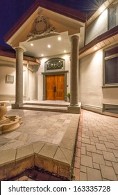 House entrance. Fragment of the big luxury house at night, disk, sunset, sunrise time in suburbs of Vancouver, Canada.
