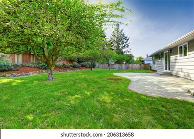 House exterior. View of backyard walkout deck and small garden
