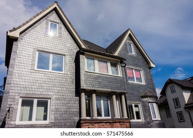 house with facade of grey shist