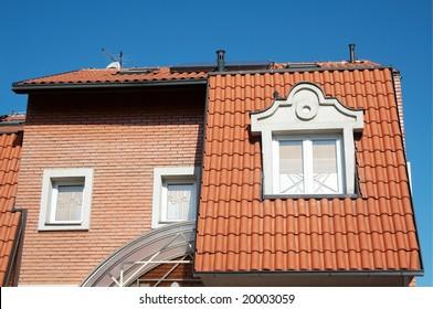 House facade on blue sky