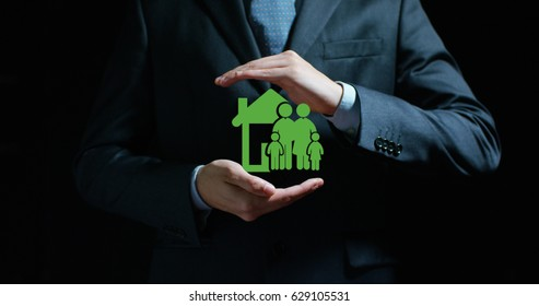 House with the family in the hands of an experienced seller or bank or insurance broker. Concept: for investment and passive income for retirement and annuities also, of insurance or health insurance