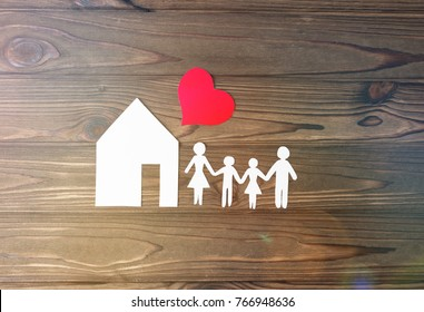 house, family, heart on a wooden background