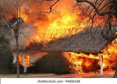 A house fire burns through the roof and spreads rapidly once it hits the open air, as oxygen acts as fuel for the fire.