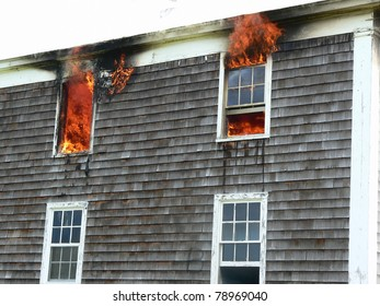 house fire with flames in windows