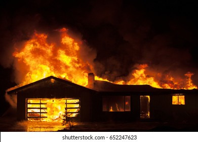 House fire at night with room for text