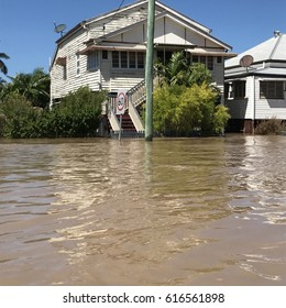 House in flooded street Rockhampton 2017
