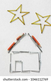 house formed with screws and stars formed with a yardstick