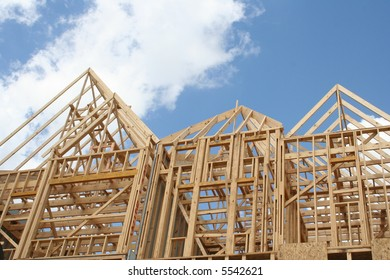 House frame against blue sky and clouds