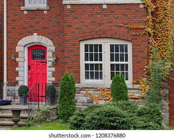 house front door with vines in fall colors