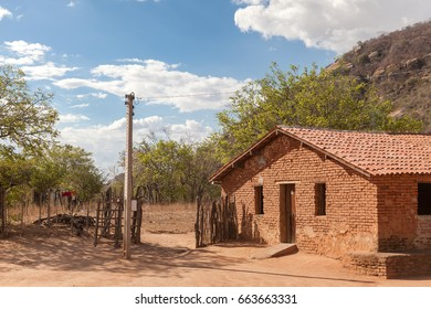 House in the front of mount rock at northeast region of Brazil