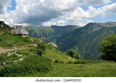 A house in front of a mountain range in rural Bosnia-Herzegovina