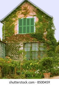 A house with a garden full of flowers.