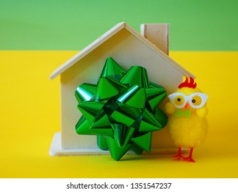 House as gift, ribbon and chicken toy