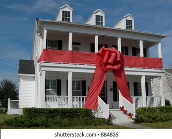 house gift-wrapped with giant red bow