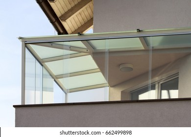 House with a glass balcony and roof