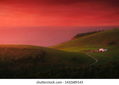 house in Gorliz near the sea with red sunset sky
