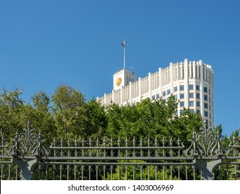 House of the Government of Russian Federation (White House). Bottom view of Russian Government House with flag. Famous state building against clear blue sky. Moscow, Russia.