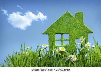 house from grass on blue sky