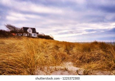 House in the grass on the dunes at the Baltic Sea.
