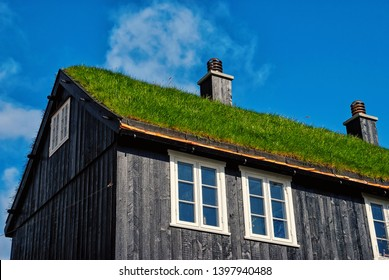 House with grass roof in Torshavn, Denmark. Eco friendly building. Architecture and design. Destination place. Ecology and environment. Summer vacation in countryside.