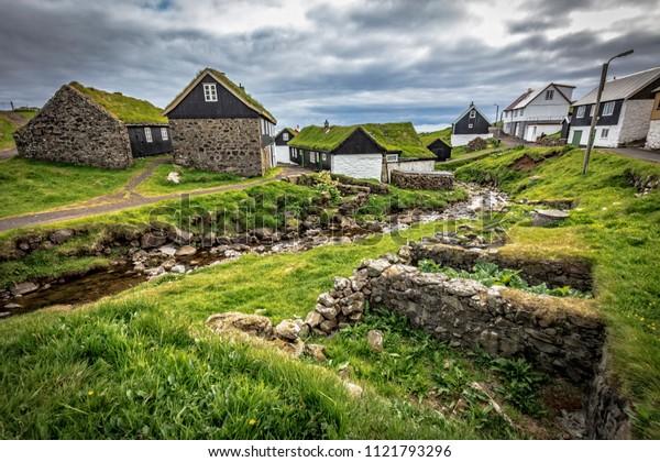 house with green roof in mykines faroe islands