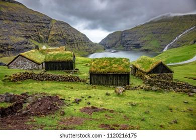 house with green roof in saksun, faroe islands