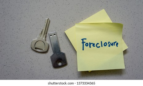 House or home model with text foreclosure. Property or real estate concept.