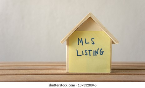 House or home model with text MLS (Multiple listing service) Listing (For Sale by Owner). Property or real estate concept.