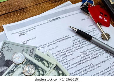 House, home, property, real estate lease rental contract agreement pen money coins keys wooden background, expenses, buying, investment, finance, savings, concept close up