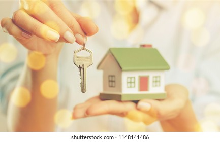 House in human hand and light illustration