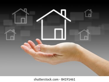 house icon in human hands