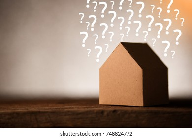 house ideas concept with house shape papercut and question mark with blur background and free copyspace for your text