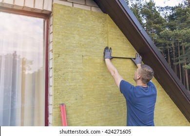 house insulation - insulating house facade with mineral rock wool