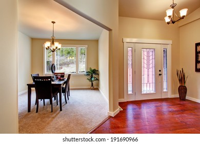 House interior. View of entrance hallway and dining area with served table