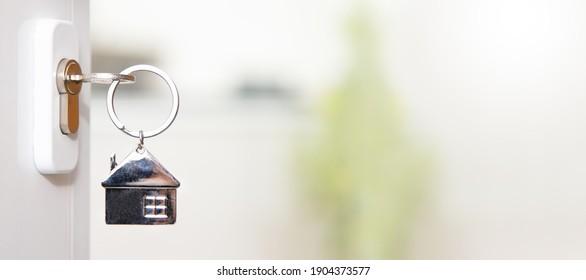 house key in the door