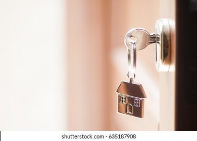 House key in the door - Shutterstock ID 635187908