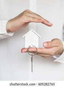 House key in home Insurance agent's hand protection